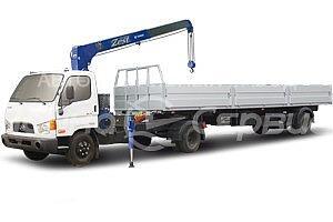 Седельный тягач с полуприцепом Hyundai-78 с КМУ Tadano
