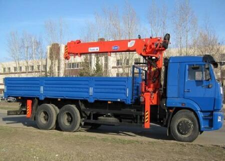 Бортовой КамАЗ 65117 с кму Kanglim KS2056H, борт 6400