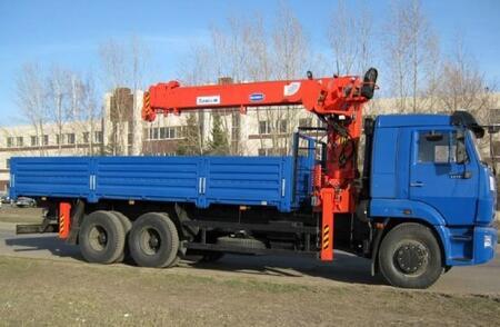 Бортовой КамАЗ 65117 с Кму Канглим KS1256G-II