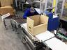 Автоматизированная конвейерная линия упаковки колбасных изделий в короба.