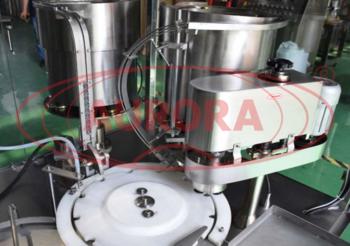 Автоматическая линия для забивки резиновых пробок и завальцовки алюминиевых колпачков